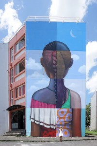 Large mural on building by Julien Malland