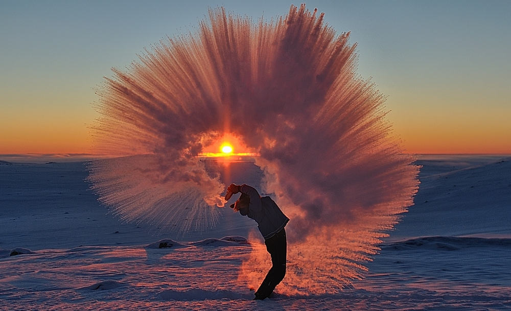 Pouring hot tea at -40°C Near the Arctic Circle