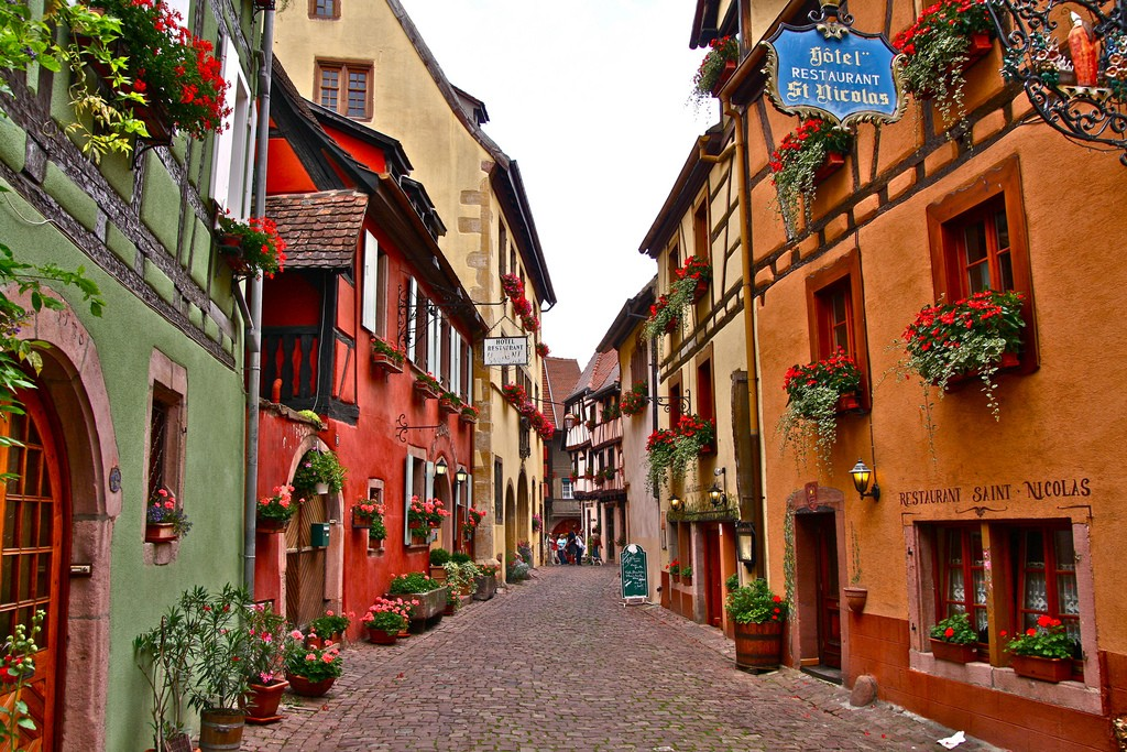 Here's a place you haven't heard of yet - Eguisheim is a commune in Alsace, France renowned for its high quality wines. Other than great wines? Great colored old houses and streets!