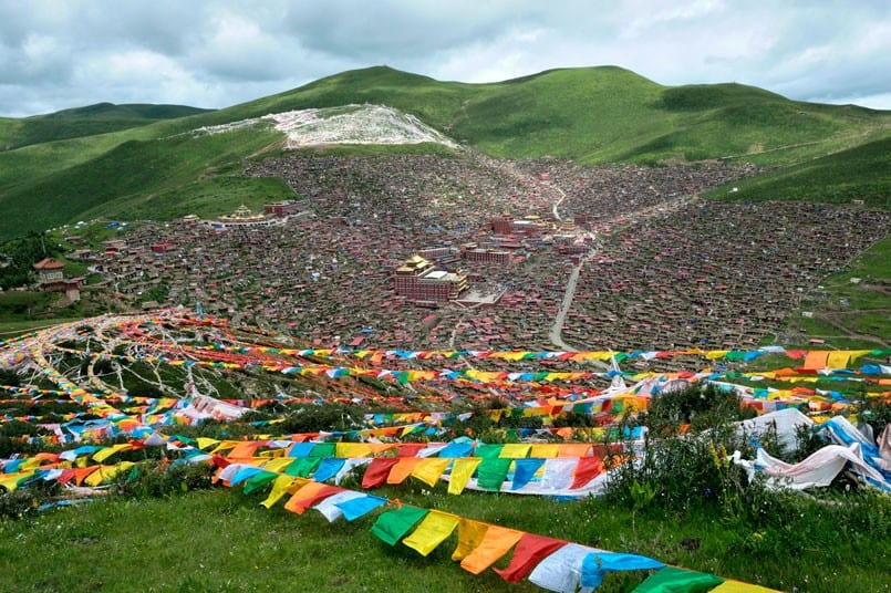 Thousands of tiny homes sprawl up a mountainside forming one of the world's largest Buddhist Institutes.
