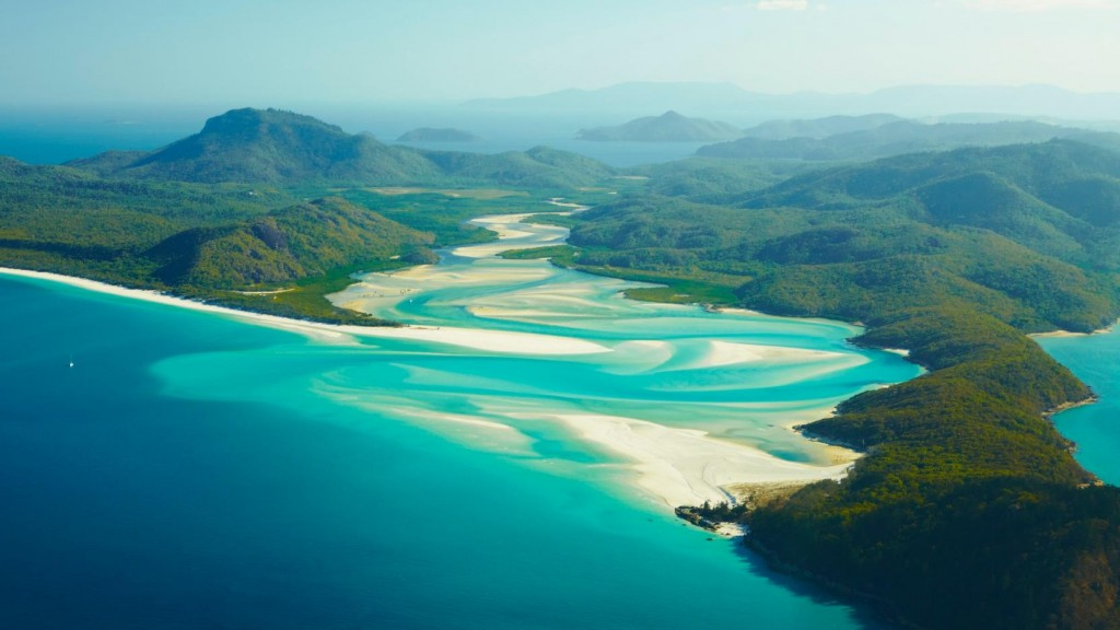Among many other attactions, Australia's aquatic experiences are pure bliss. Pictured above: Whitehaven Beach and Hamilton Island, Queensland