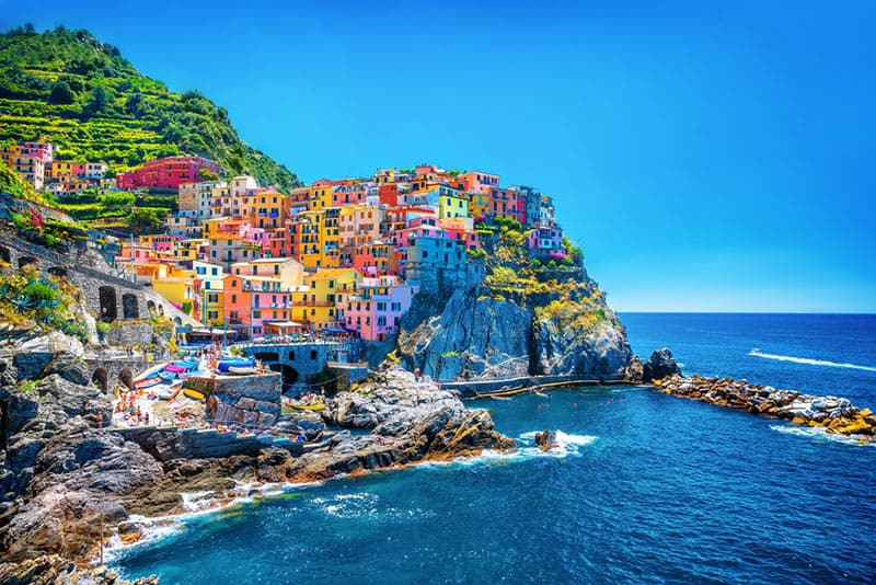 Cinque Terre is actually a string of five old seaside villages on the rugged Italian Riviera coastline. All of the 5 little towns are blazing with color.