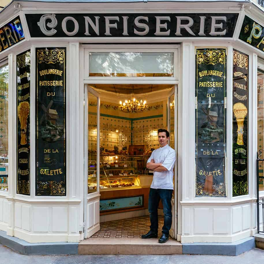 Boris Lumé, standing proudly at the entrance of his picturesque bakery-confectionery